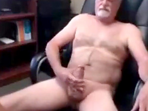 Gray-haired grandfather cums sitting on a chair in the hallway