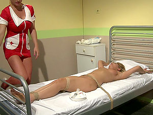 Hot nurse Katy Parker drills Tiana's vag with a faux-cock