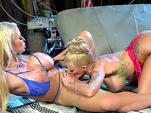Sexy lesbian Joslyn James uses her tongue to please her busty girl