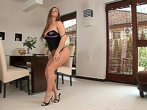 Rita Faltoyano strips and plays with her meaty snatch