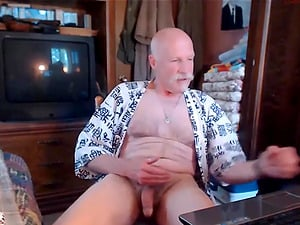 Handsome grandpa with a grey mustache jerking off and shooting his load