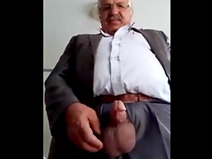 Arab daddy with a big cock jerks in front of the camera