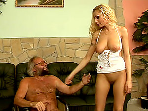 Sexy blonde nurse Trisha fucks some elderly dude on a sofa