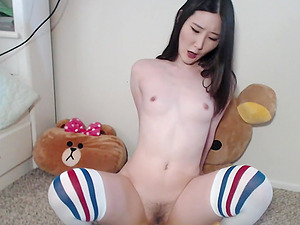 Horny asian babe with buttplug shoves a big dildo into her hairy pussy