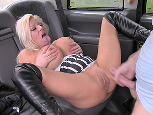 Blonde whore with huge fake tits gets her panties off for a taxi driver
