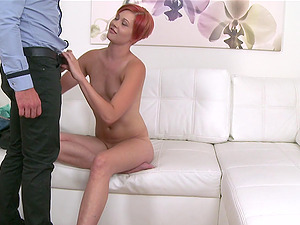 Redhead slut takes off her clothes and rides a cock during casting