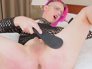 Pink haired ugly shemale teases with her asshole and a tiny dick