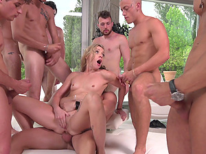 Hardcore gangbang for blonde model Cherry Kiss in the open