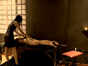 Mistress whips male sub in a dungeon