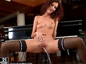 Curly Leanna Sweet masturbates near the piano