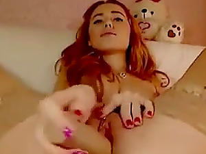 Lovely redhead girlfriend sucking and fucking dildo on webcam