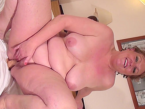 Fat mature with big saggy tits pleasuring herself with a dildo