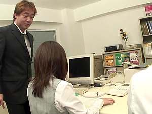 Japanese secretary plays with her sex toys while in her boss's lap