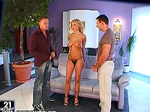Trisha the kinky blonde gets dual penetrated on a sofa