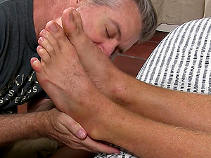 Sleeping guy gets his feet licked and kissed by an old pervert