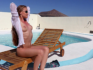 Horny Angel B can't wait to get back to the room so she plays by the pool