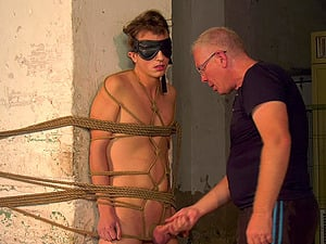 Video of a skinny guy tied up and tortured by a dirty mature pervert
