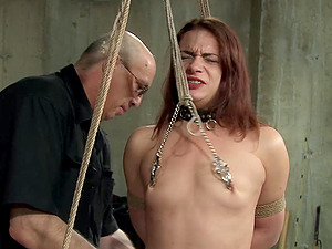 Naughty pervert tied up a sexy redhead chick and tortures her