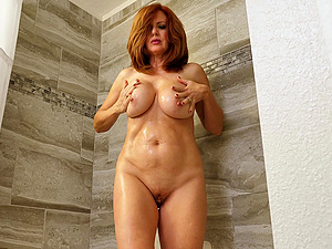 You'll want to watch Andi James having fun in the steamy shower