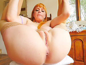 Cock hungry redhead Penny moans while masturbating on the chair