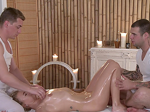 Two dudes team up to massage and spit-roast a sexy blonde model