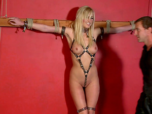 Sexy blonde slave girl Victoria White moans with pleasure during torture
