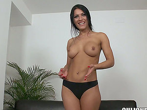 Beautiful black-haired stunner has her poon checked for a porno