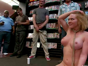 Big-titted blonde woman gets fucked in a shop in public