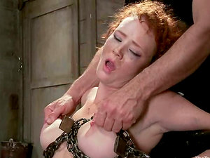 Ginger-haired Audrey Hollander gets chained and face fucked