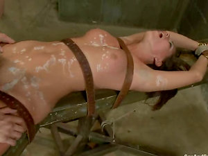 Tied up with straps Rilynn Rae gets fucked after paraffin wax session
