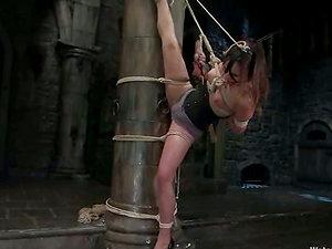 Subjugated Amber Rayne in water restrain bondage movie