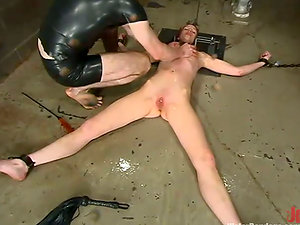 Kory Vixen squeals noisily while being tormented in a basement