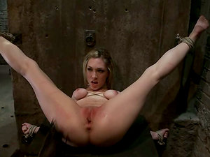 Hog tied blonde gets toyed and fingerblasted in a dungeon space