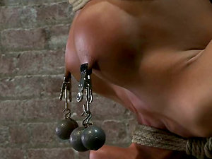 Tied up to a post gargles a hard-on and gets toyed