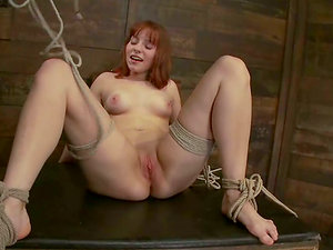 Red-haired Chamille gets tied up and toyed on a table
