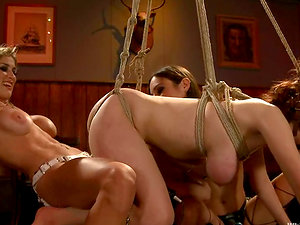 Amber Rayne gets hogties and suspended for the possession of two