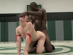 Two chicks grapple in a ring and get fucked by Black man
