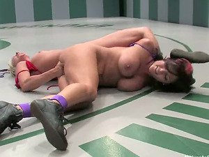 Buxom black-haired gets toyed by a blonde after a fight