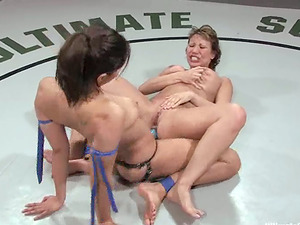 Isis Love playthings Ava Devine with a strapon during a fight