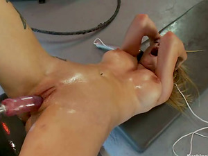 Hot Rain DeGrey gets toyed by a machine in her humid cunt