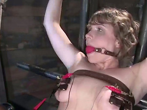 Layla Kay gets her wired snatch toyed and fucked with a strapon