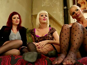 Three lewd lesbos showcase their foot-fucking abilities to each other