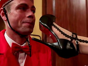 Motel Guest Maitresse Madeline Predominates the Bellboy in Foot worship Vid