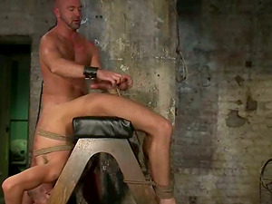Dominic arches Josh and bondages his nut