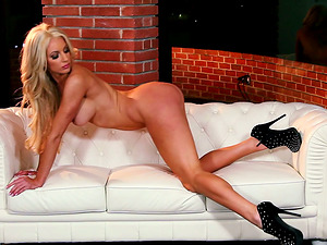 Nicolette Shea shows her big faux tits at a Playboy photo shoot