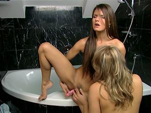Kinky girl-on-girl scene in the bathroom with Regina and Suzie