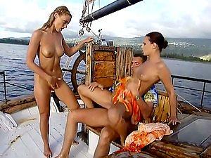 Claudia and Maya fuck a stud on a ship deck in FFM vid